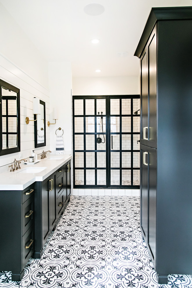 Inspiration for a cottage master multicolored floor bathroom remodel in Salt Lake City with shaker cabinets, black cabinets, white walls and an undermount sink