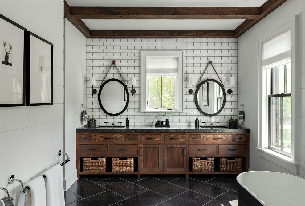 Large country master white tile and subway tile slate floor and black floor freestanding bathtub photo in New York with flat-panel cabinets, white walls, an undermount sink, concrete countertops, black countertops and dark wood cabinets