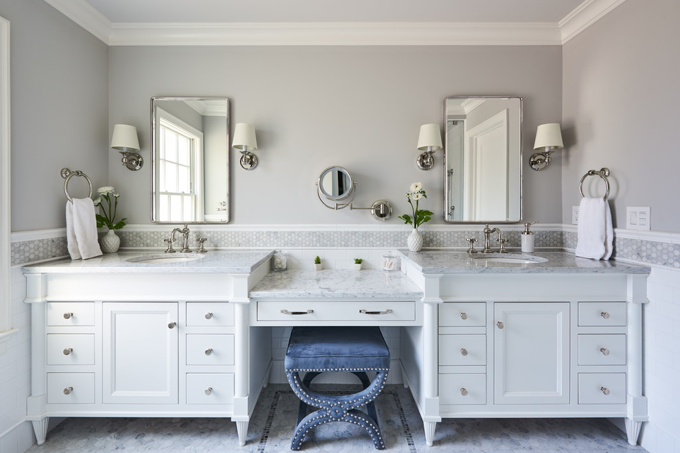 Example of a transitional white tile and subway tile gray floor bathroom design in New York with furniture-like cabinets, white cabinets, gray walls, an undermount sink and gray countertops