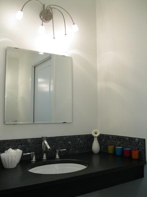 Modern guest bathroom with black limestone penny tile and black granite modern-bathroom