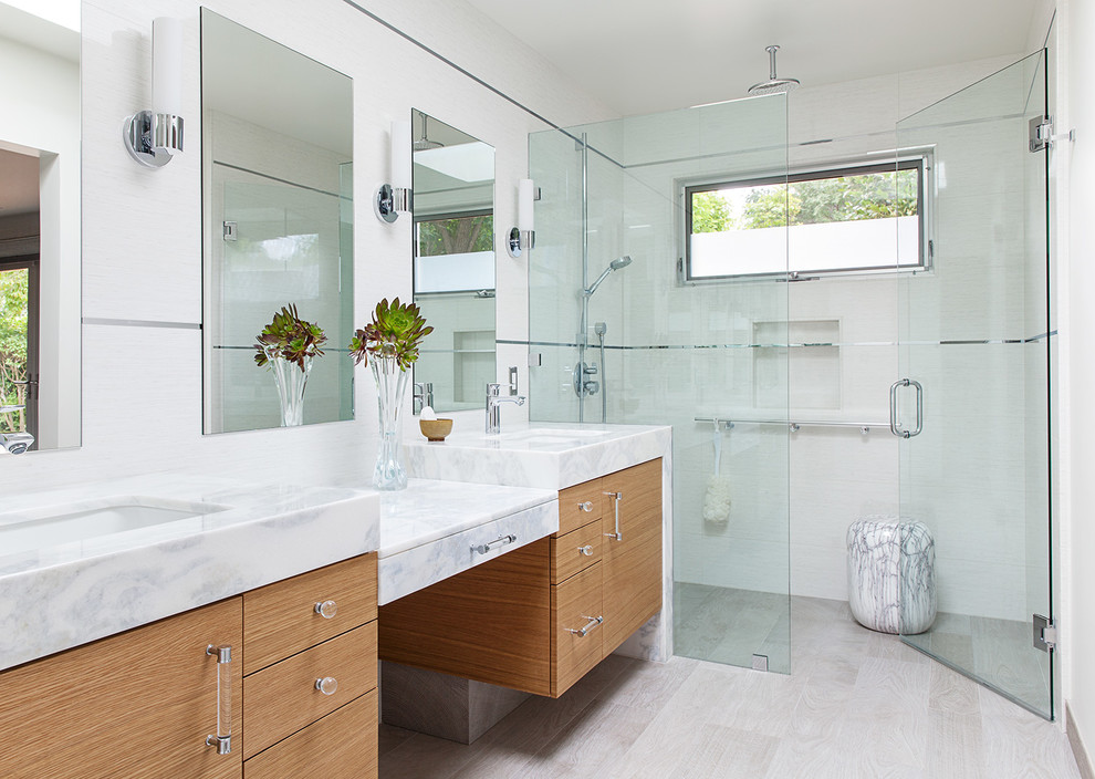 Inspiration for a huge modern master gray tile and porcelain tile porcelain floor walk-in shower remodel in San Francisco with flat-panel cabinets, medium tone wood cabinets, a one-piece toilet, white walls and an undermount sink
