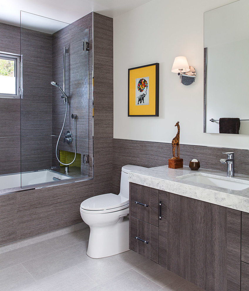 Mid-sized minimalist kids' gray tile and porcelain tile porcelain floor tub/shower combo photo in San Francisco with flat-panel cabinets, distressed cabinets, an undermount tub, a one-piece toilet, white walls, an undermount sink and marble countertops