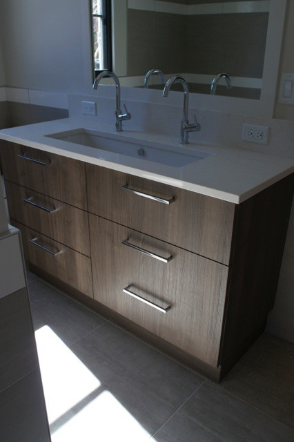 Inspiration for a modern bathroom remodel in Denver with flat-panel cabinets and medium tone wood cabinets