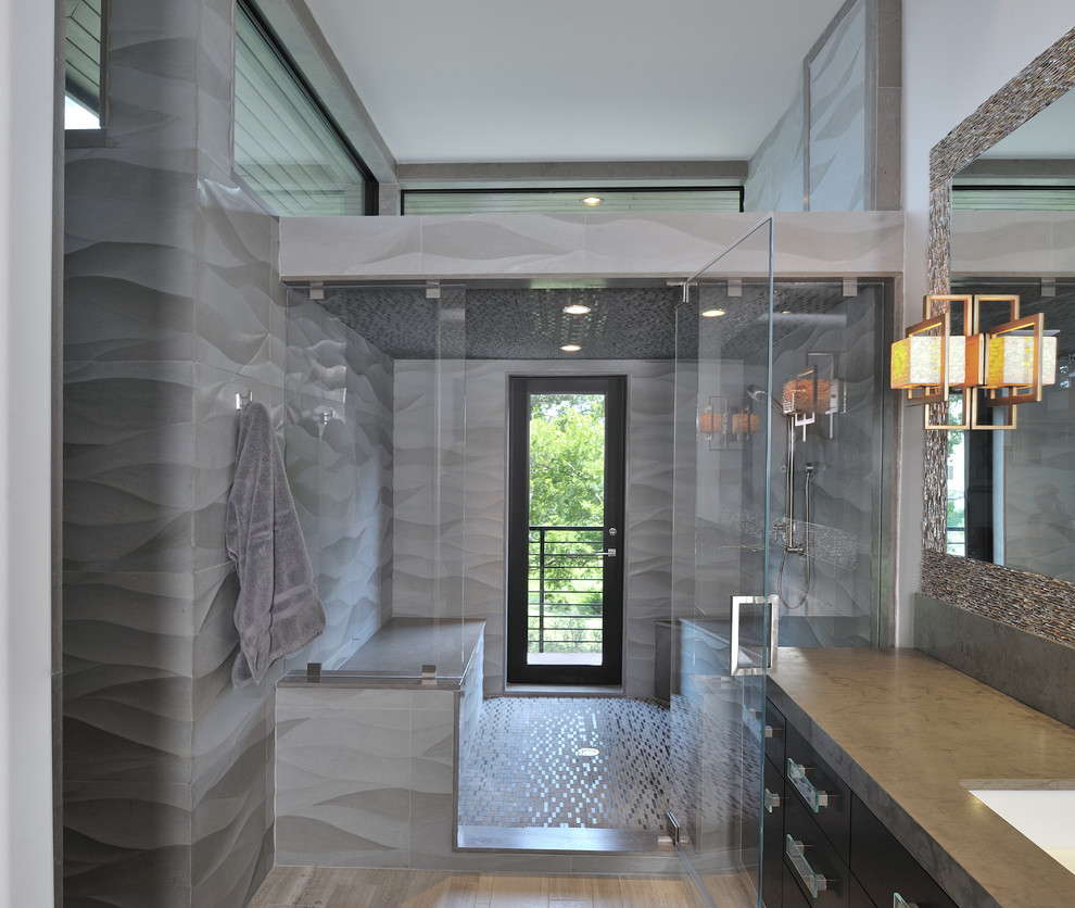 Example of a trendy gray tile alcove shower design in Houston with an undermount sink and flat-panel cabinets