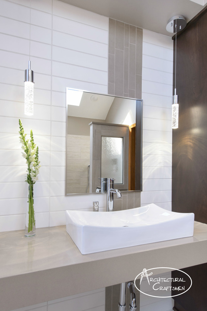 Minimalist master gray tile and porcelain tile porcelain tile doorless shower photo in Kansas City with a wall-mount sink, quartz countertops and green walls