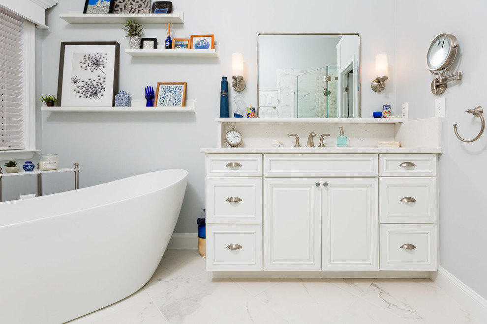 Freestanding bathtub - modern freestanding bathtub idea in DC Metro with raised-panel cabinets, white cabinets, gray walls, an undermount sink, a hinged shower door and white countertops