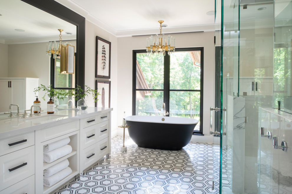 Inspiration for a transitional multicolored floor and single-sink freestanding bathtub remodel in Minneapolis with recessed-panel cabinets, white cabinets, beige walls, an undermount sink, white countertops and a built-in vanity