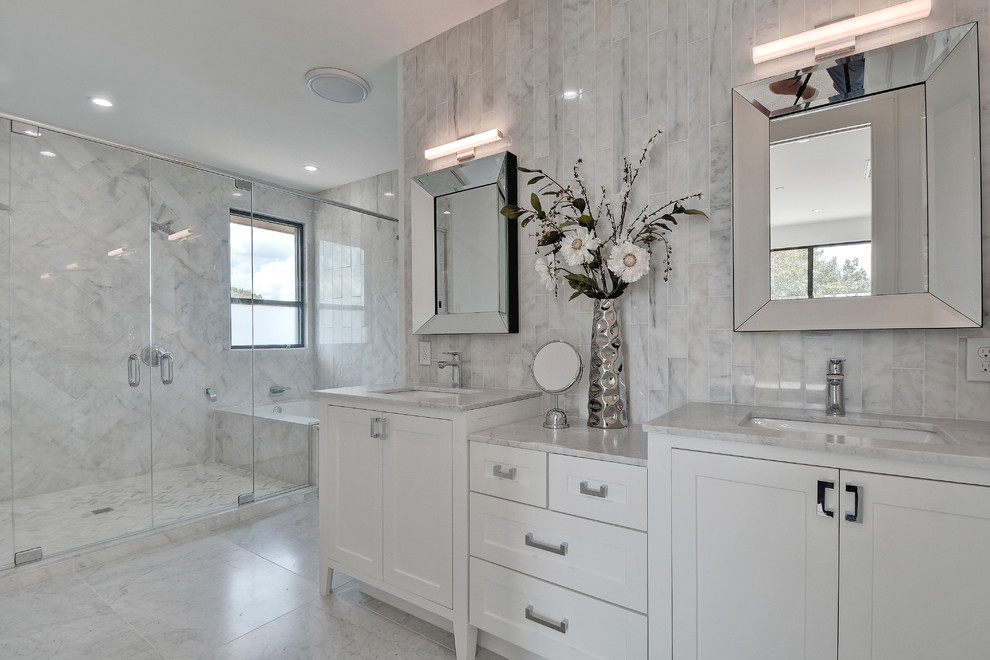 Large transitional master gray tile and marble tile marble floor and white floor alcove shower photo in Nashville with shaker cabinets, white cabinets, an undermount sink, an undermount tub, a one-piece toilet, marble countertops, gray walls, a hinged shower door and white countertops