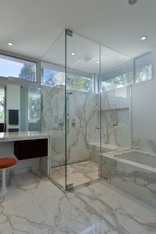 Inspiration for a modern white tile corner shower remodel in San Francisco with an undermount sink, flat-panel cabinets and dark wood cabinets