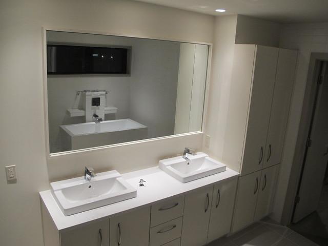 Modern Urban Bathroom With White High Gloss Cabinets Kansas City