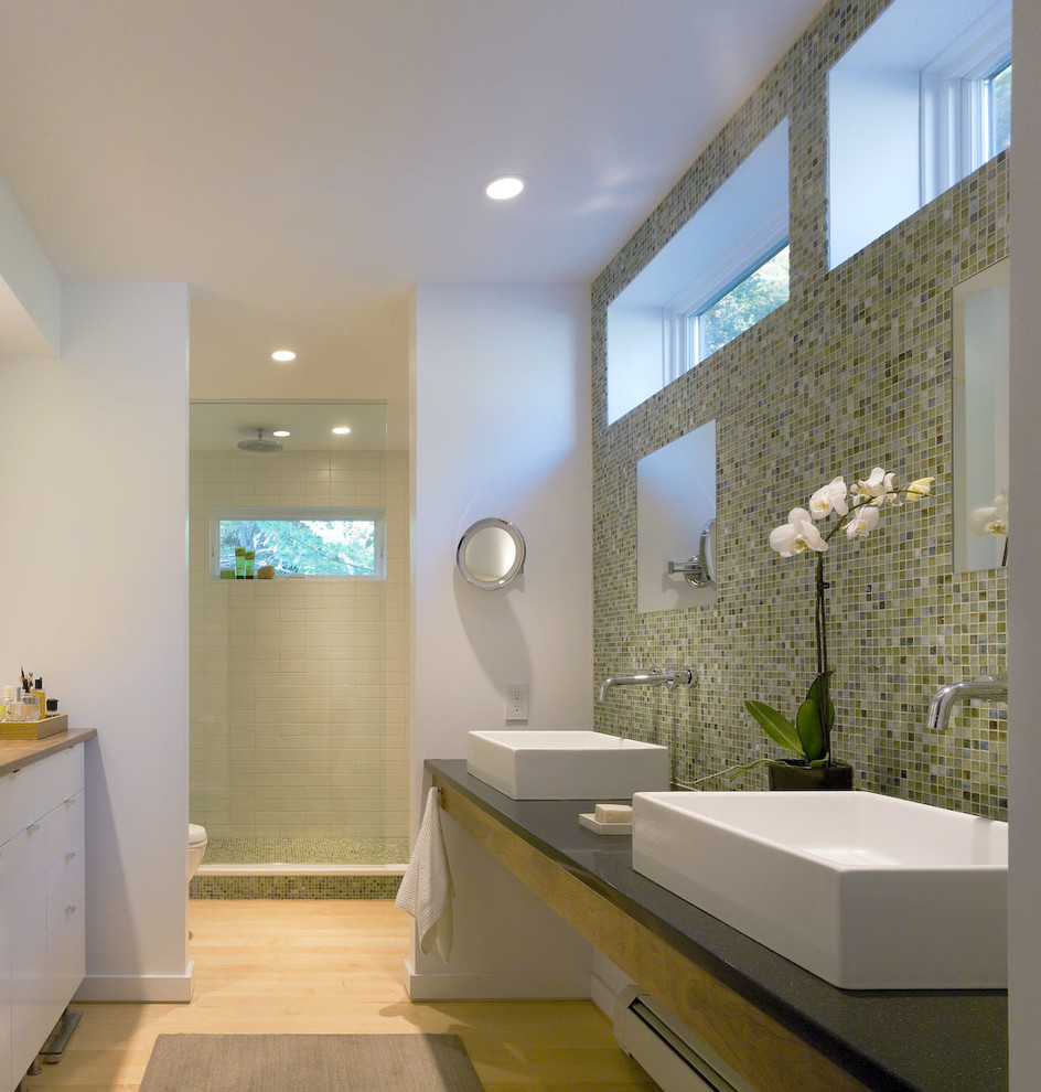 Inspiration for a modern mosaic tile light wood floor alcove shower remodel in Burlington with a vessel sink, flat-panel cabinets, white cabinets and white walls