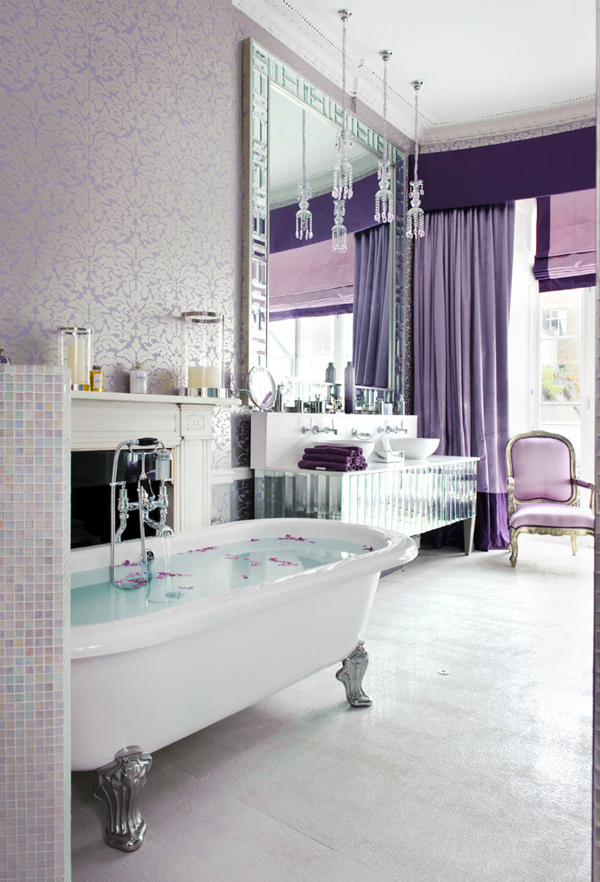 Example of a large trendy master multicolored tile and mosaic tile claw-foot bathtub design in London with a vessel sink and purple walls