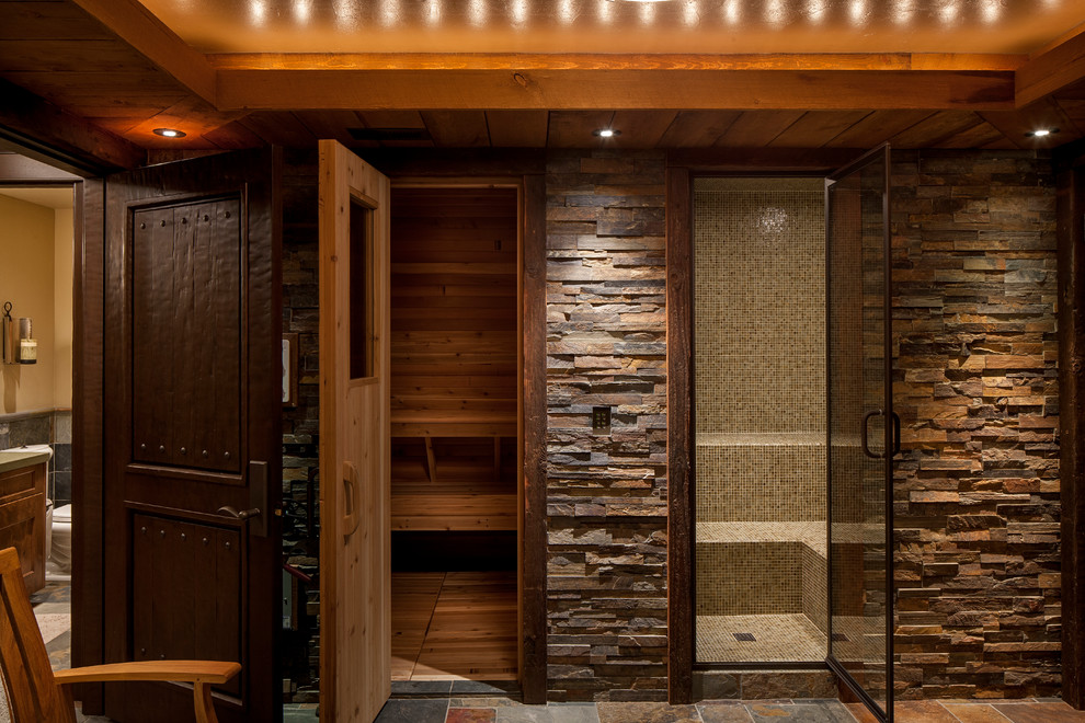 Inspiration for a large rustic slate floor and multicolored floor bathroom remodel in Other with brown walls, furniture-like cabinets, dark wood cabinets and an undermount sink