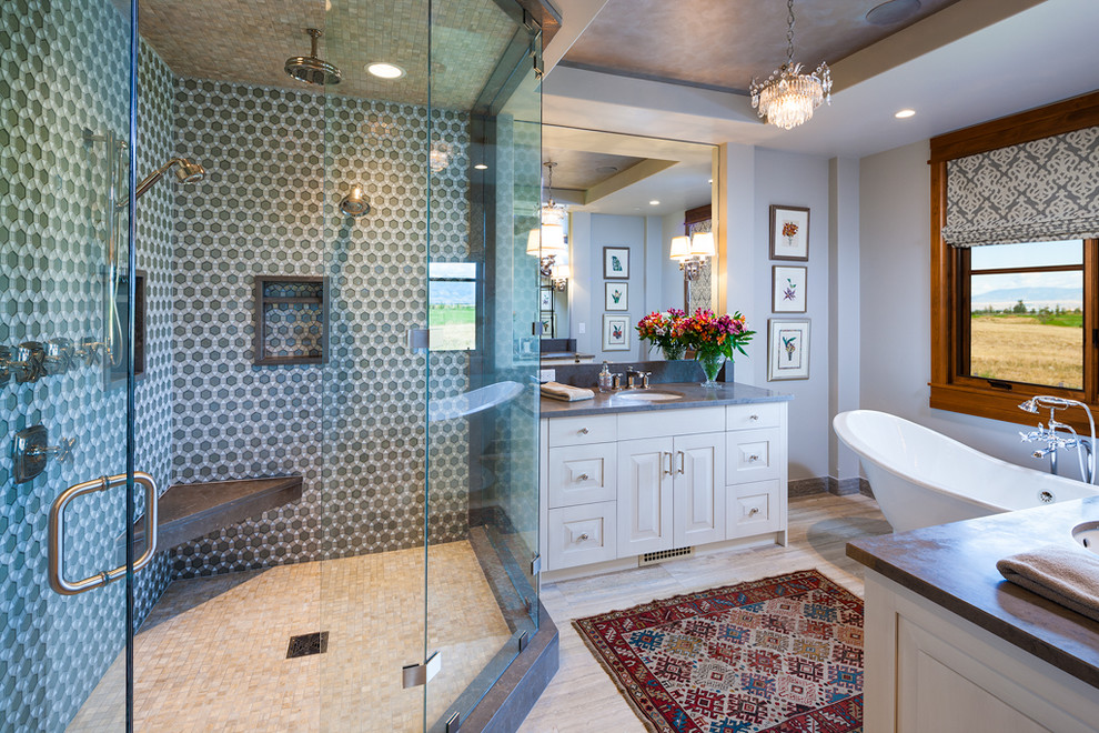 Trendy gray tile bathroom photo in Other with an undermount sink, raised-panel cabinets and white cabinets