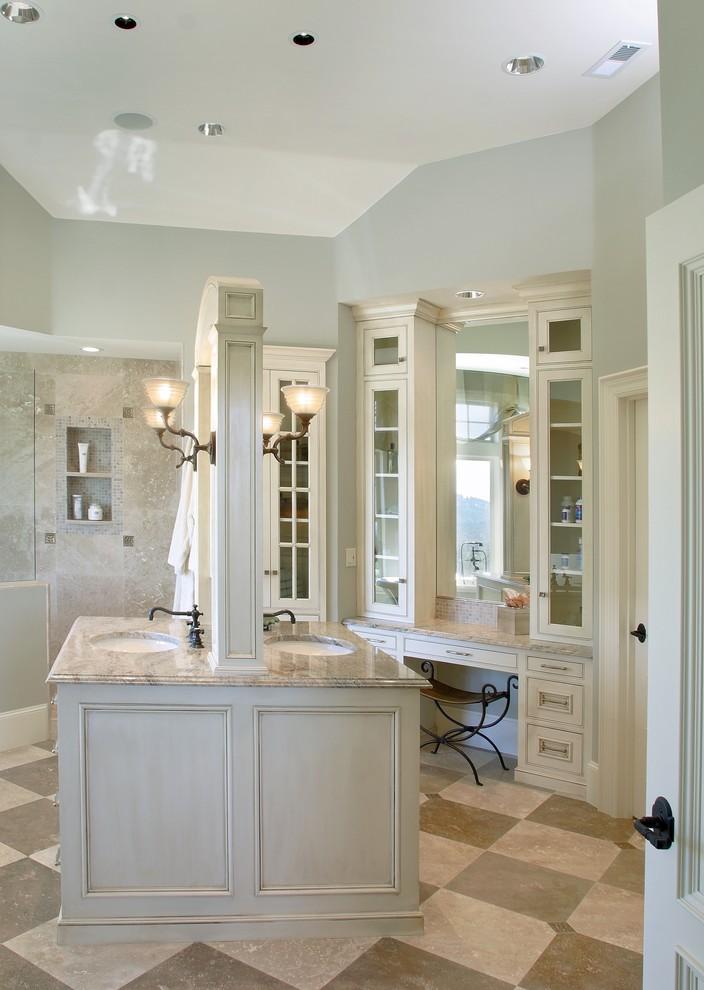 Elegant beige tile bathroom photo in Portland with an undermount sink