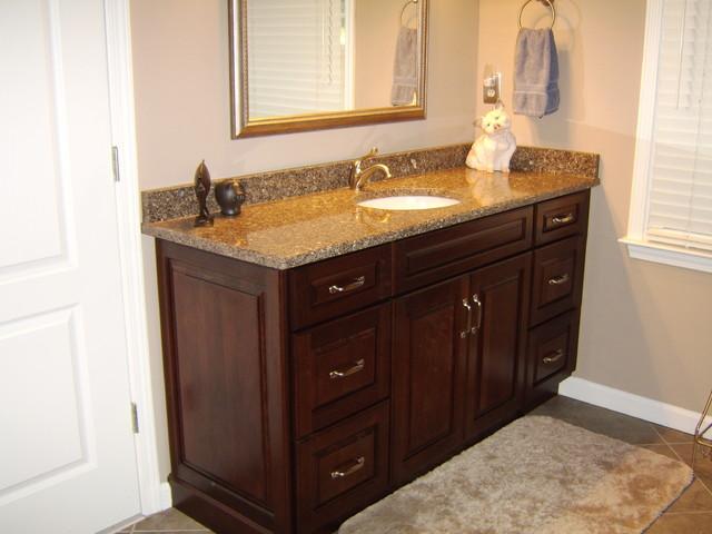 Montclair cherry by kraftmaid traditional bathroom for Kraftmaid bathroom designs