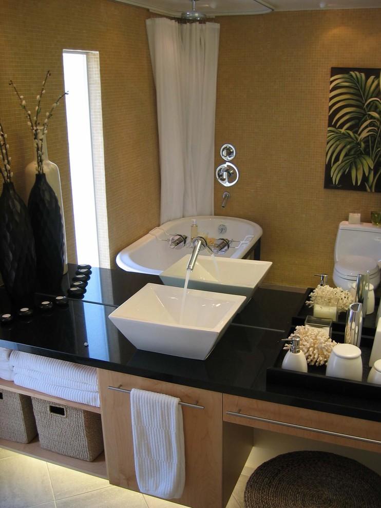Freestanding bathtub - contemporary mosaic tile freestanding bathtub idea in San Francisco with a vessel sink