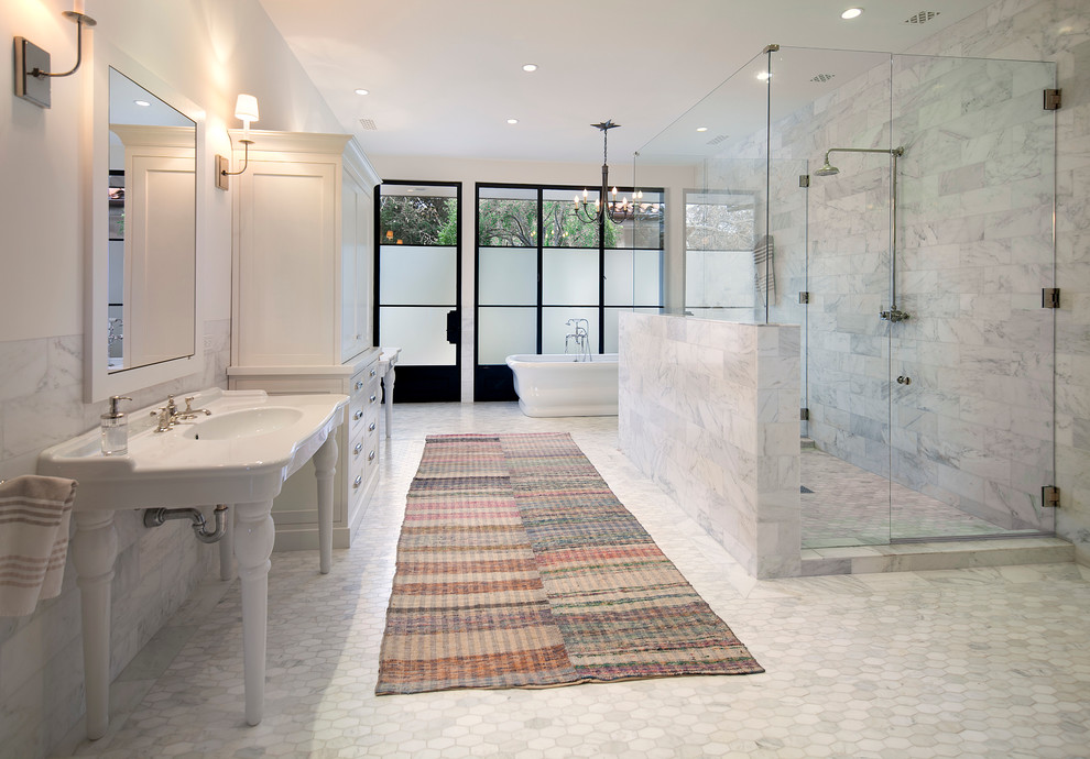 Large elegant master white tile and stone tile mosaic tile floor freestanding bathtub photo in Santa Barbara with shaker cabinets, white cabinets, a console sink and white walls