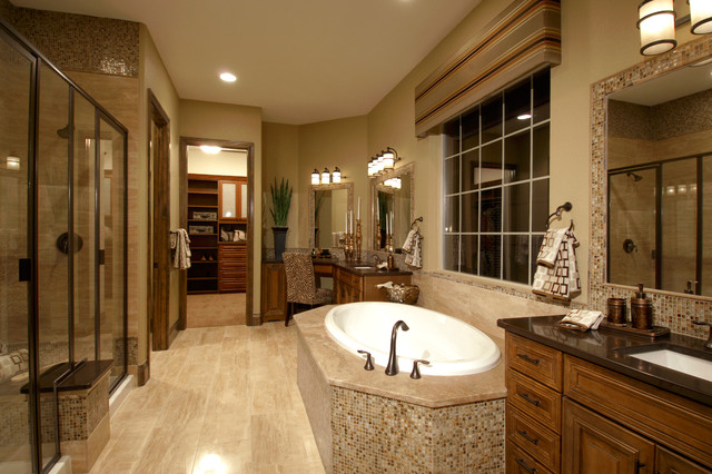 Inspiration for a mediterranean beige floor drop-in bathtub remodel in Denver with an undermount sink, brown walls and brown countertops