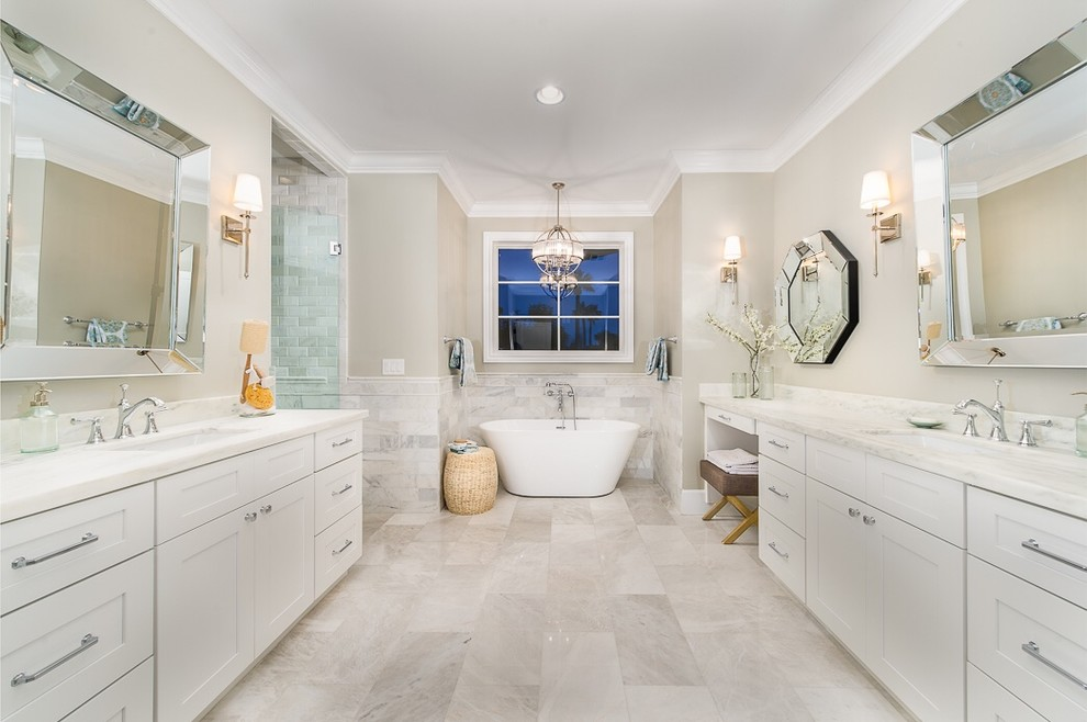 Bathroom - large transitional master stone tile bathroom idea in Phoenix with recessed-panel cabinets, white cabinets, beige walls, an undermount sink and a hinged shower door