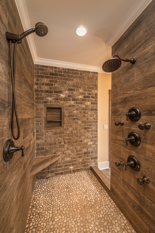 What is the wood tile used on the shower walls?