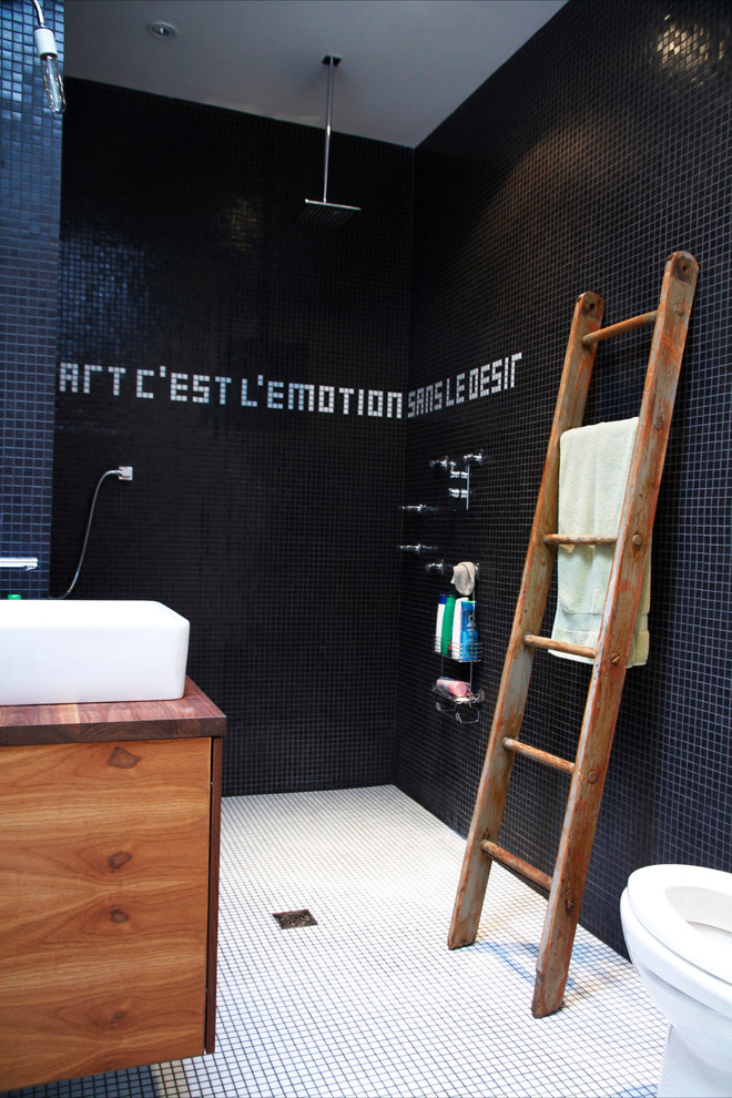 Inspiration for an industrial mosaic tile bathroom remodel in Montreal