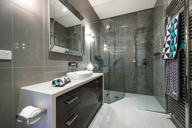 Inspiration for a small contemporary gray tile and mosaic tile porcelain floor double shower remodel in Melbourne with flat-panel cabinets, dark wood cabinets, gray walls, a console sink, engineered quartz countertops and a hinged shower door