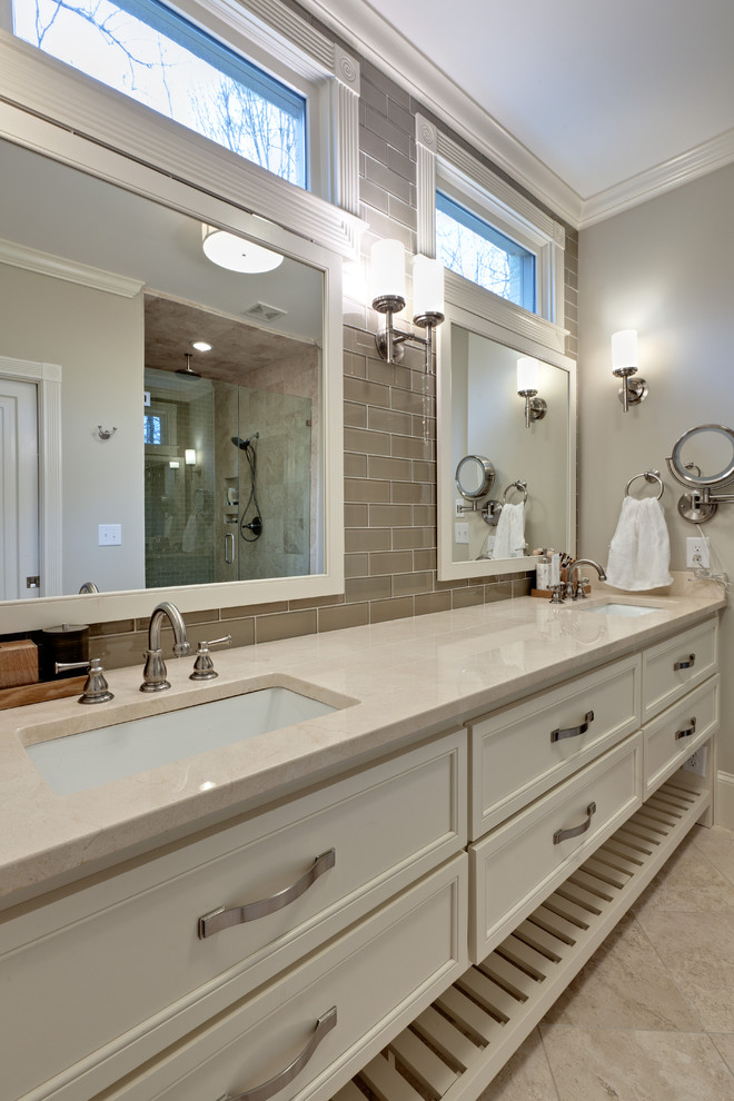 Example of a mid-sized classic master beige tile and ceramic tile ceramic floor and beige floor alcove shower design in Atlanta with an undermount sink, furniture-like cabinets, white cabinets, gray walls, engineered quartz countertops and a hinged shower door