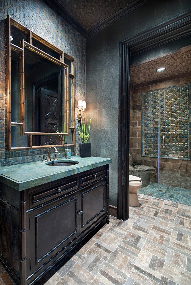 Walk-in shower - mediterranean 3/4 blue tile, brown tile, green tile and mosaic tile mosaic tile floor and beige floor walk-in shower idea in Houston with furniture-like cabinets, dark wood cabinets, green walls, an undermount sink, a hinged shower door and turquoise countertops