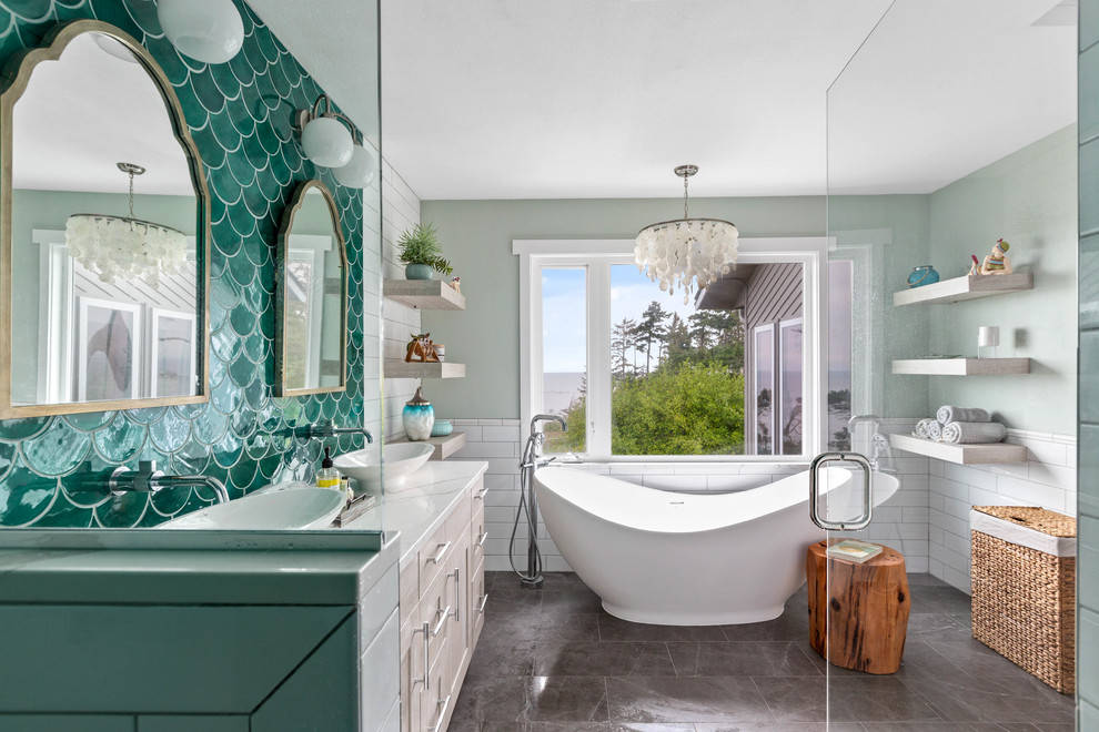 Large beach style master green tile and mosaic tile porcelain tile and gray floor bathroom photo in Seattle with gray cabinets, a one-piece toilet, white walls, a vessel sink, quartz countertops, a hinged shower door and white countertops