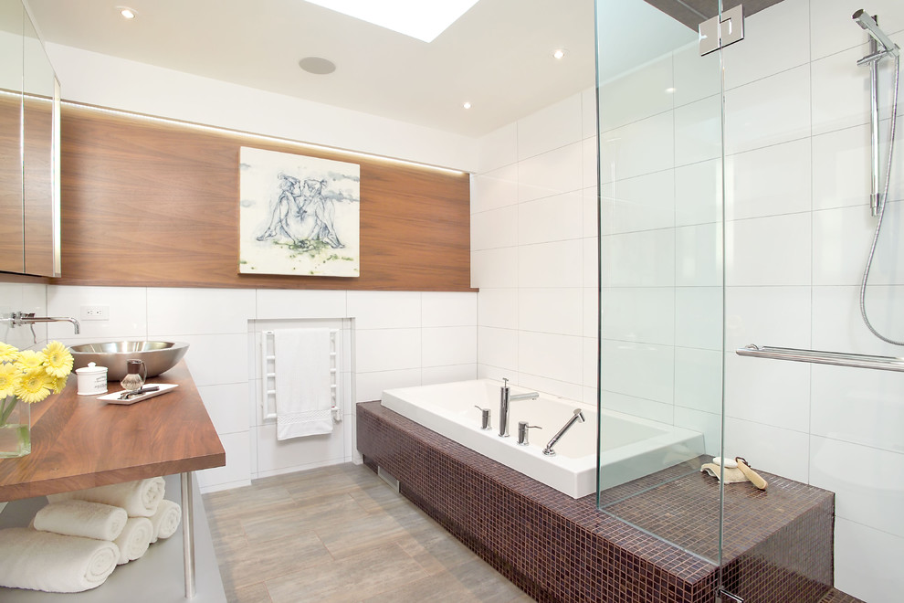 Example of a trendy white tile and ceramic tile porcelain tile bathroom design in Toronto with a vessel sink, open cabinets and wood countertops