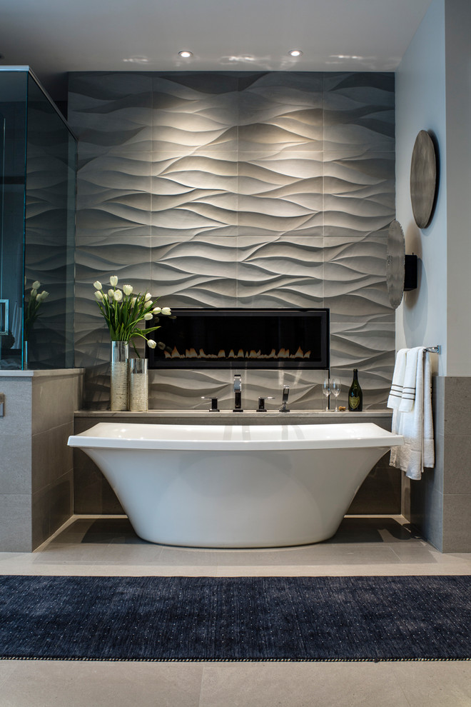 Freestanding bathtub - large contemporary master gray tile and stone tile limestone floor freestanding bathtub idea in Other with gray walls