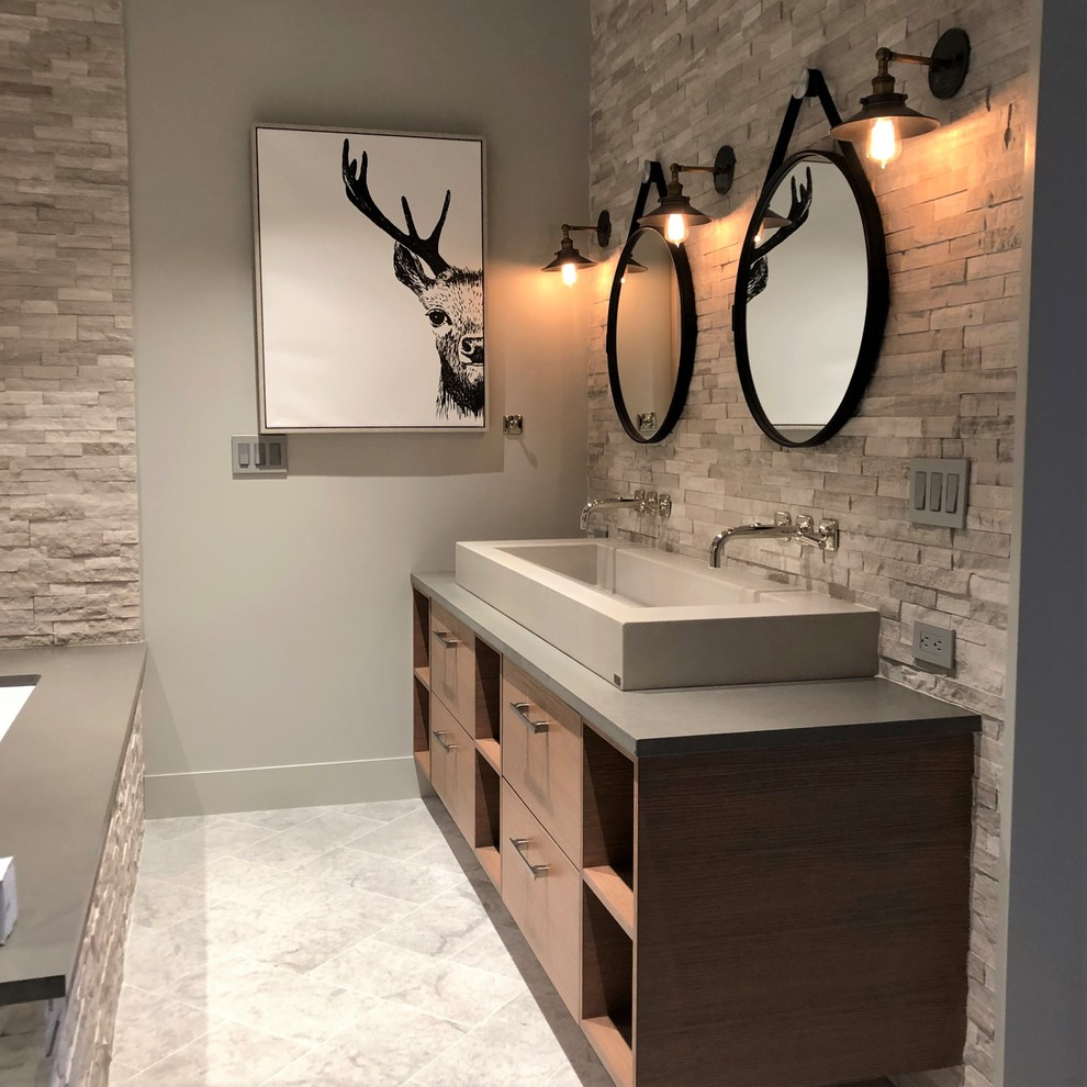Inspiration for a mid-sized contemporary master gray tile and stone tile marble floor and gray floor bathroom remodel in Denver with flat-panel cabinets, medium tone wood cabinets, a two-piece toilet, gray walls, a vessel sink, quartzite countertops and gray countertops