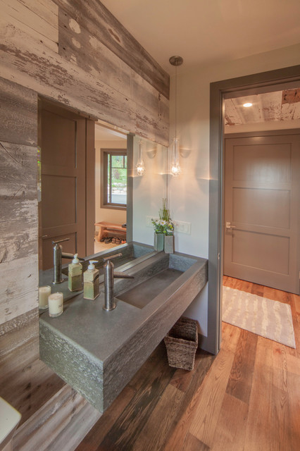 Mountain style medium tone wood floor bathroom photo in Denver with an integrated sink, beige walls and concrete countertops