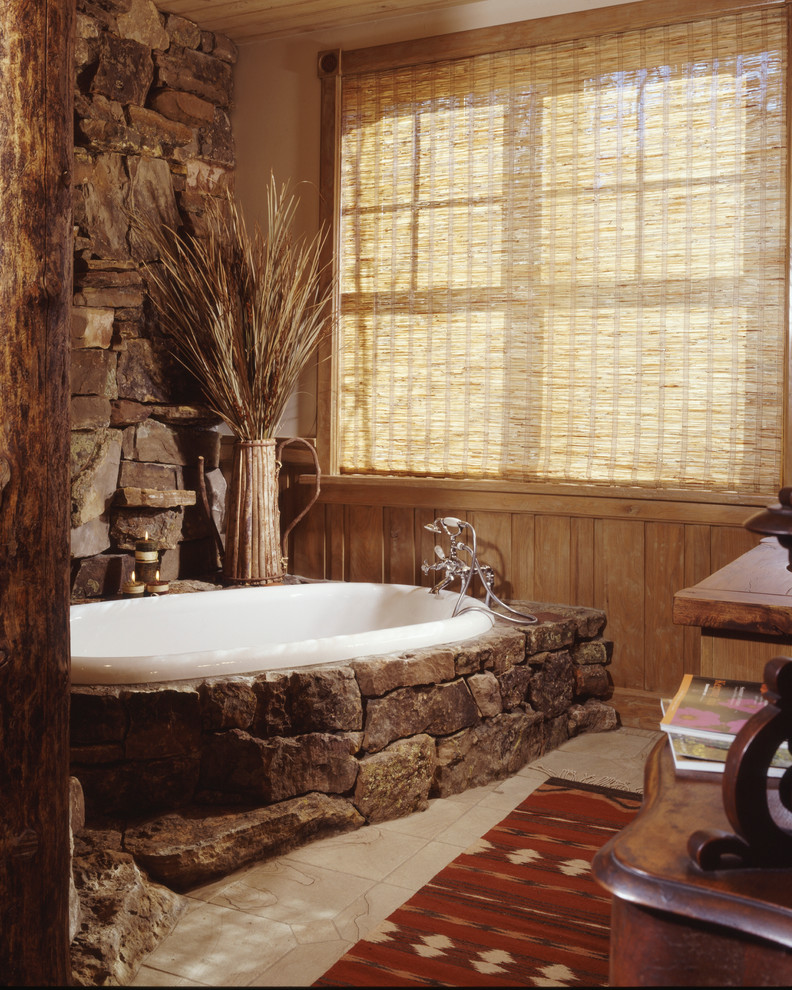 Example of a mountain style alcove bathtub design in Denver