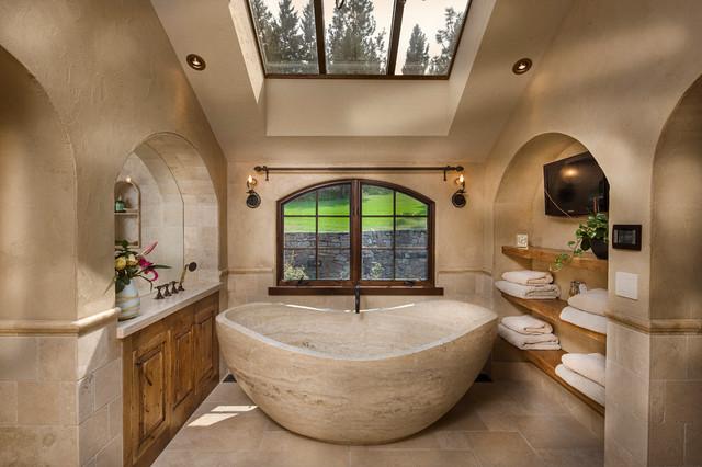 Freestanding bathtub - large mediterranean master beige tile and stone tile limestone floor and beige floor freestanding bathtub idea in Other with raised-panel cabinets, medium tone wood cabinets and beige walls