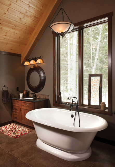 Inspiration for a mid-sized rustic master brown tile freestanding bathtub remodel in Edmonton with an undermount sink, shaker cabinets, medium tone wood cabinets, granite countertops and gray walls