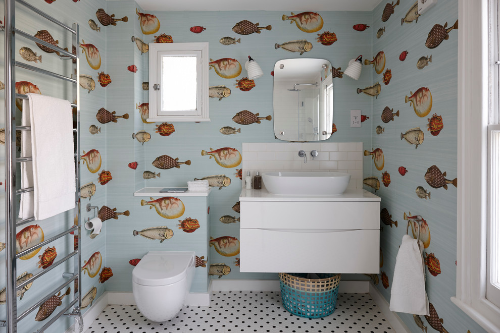 Inspiration for a mid-sized coastal kids' white tile and subway tile ceramic tile bathroom remodel in London with flat-panel cabinets, white cabinets, quartzite countertops, multicolored walls, a vessel sink and a one-piece toilet