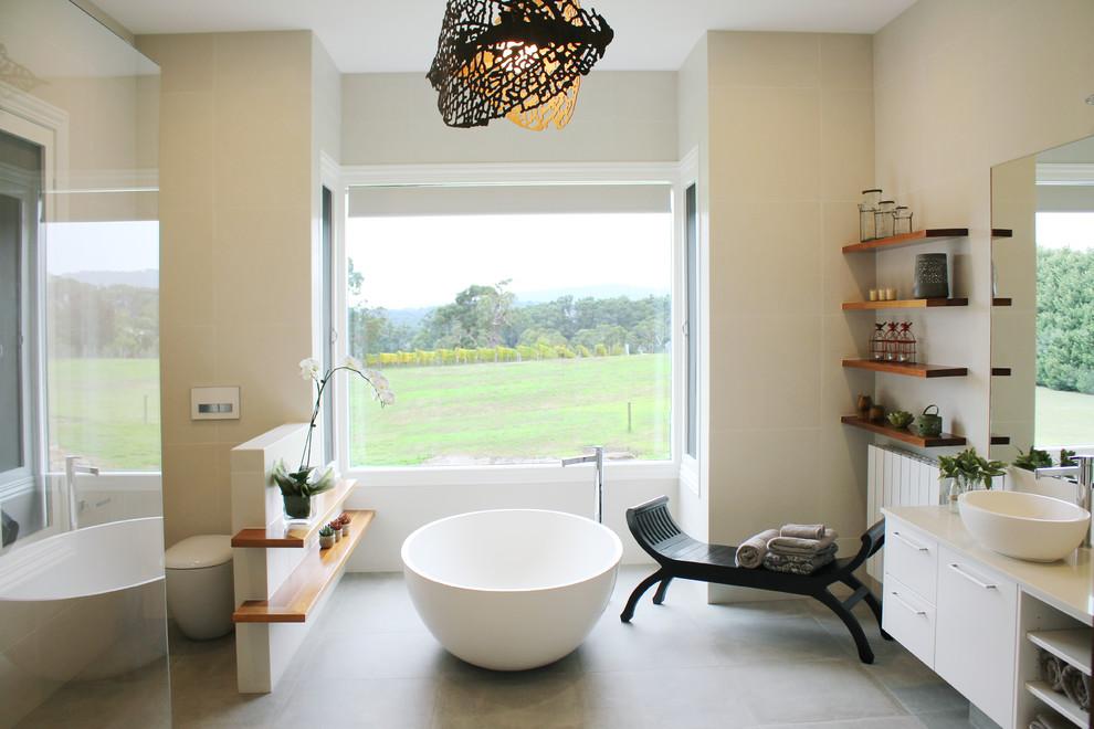 Large trendy master ceramic tile ceramic tile freestanding bathtub photo in Melbourne with white cabinets