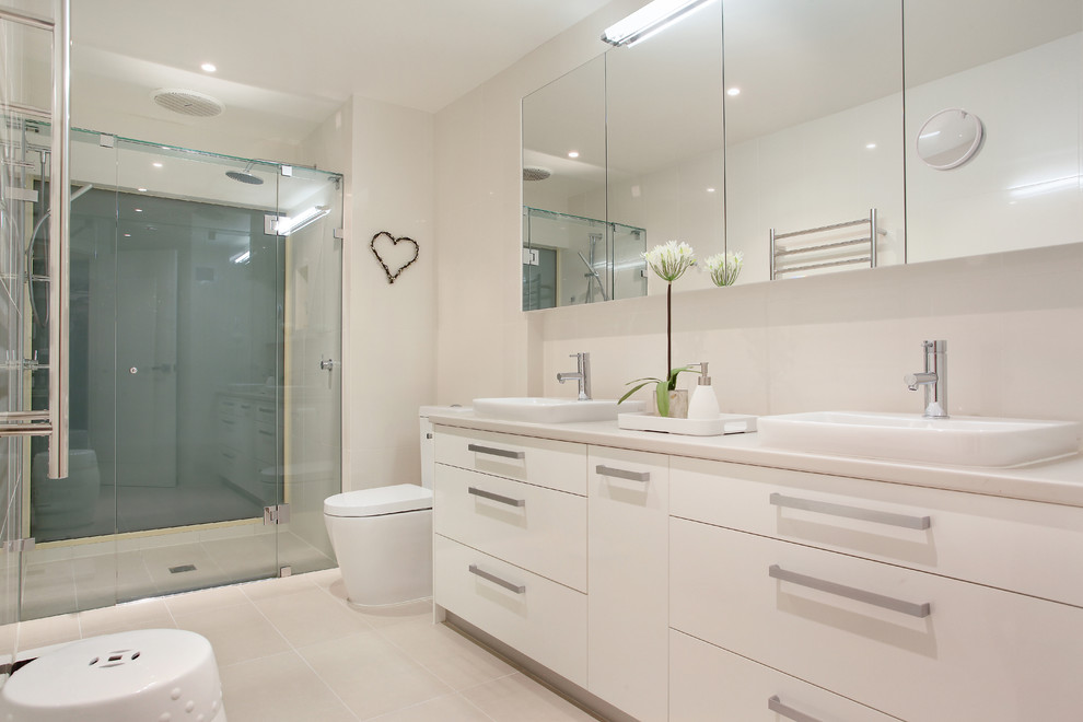 Inspiration for a contemporary alcove shower remodel in Melbourne with flat-panel cabinets, white cabinets and a drop-in sink