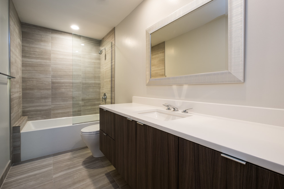 Mid-sized minimalist gray tile and porcelain tile porcelain tile bathroom photo in Portland with flat-panel cabinets, dark wood cabinets, white walls, an undermount sink and quartz countertops