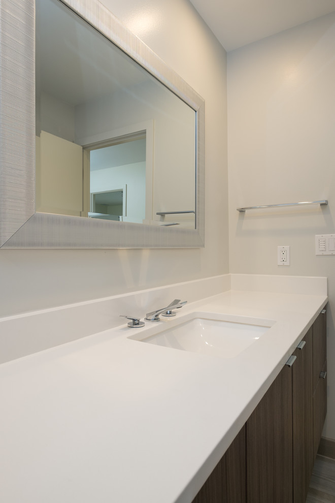 Inspiration for a mid-sized modern gray tile and porcelain tile porcelain tile bathroom remodel in Portland with flat-panel cabinets, dark wood cabinets, an undermount sink, quartz countertops and white walls