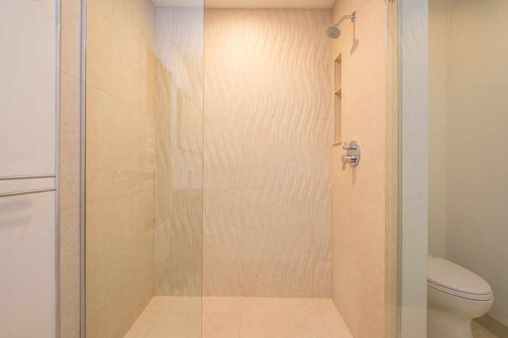 Walk-in shower - large modern master beige tile and porcelain tile porcelain tile walk-in shower idea in Portland with flat-panel cabinets, dark wood cabinets, white walls, an undermount sink and quartz countertops