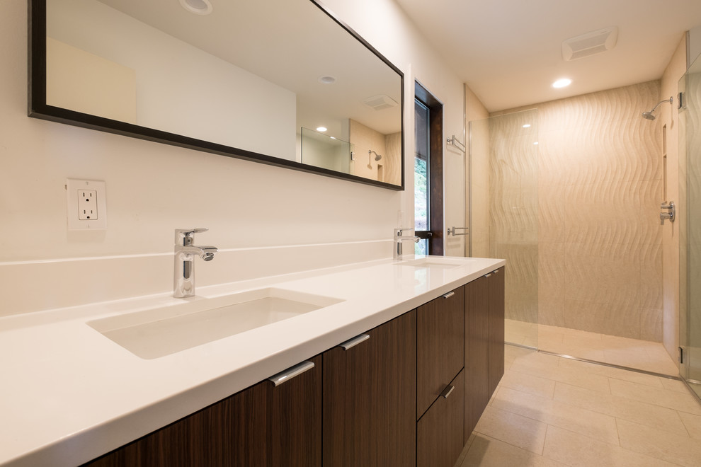 Large minimalist master beige tile and porcelain tile porcelain tile walk-in shower photo in Portland with flat-panel cabinets, dark wood cabinets, white walls, an undermount sink and quartz countertops