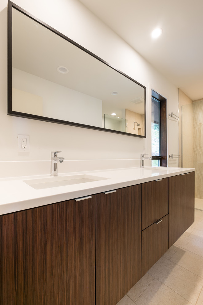Example of a large minimalist master beige tile and porcelain tile porcelain tile walk-in shower design in Portland with flat-panel cabinets, dark wood cabinets, a one-piece toilet, white walls, an undermount sink and quartz countertops