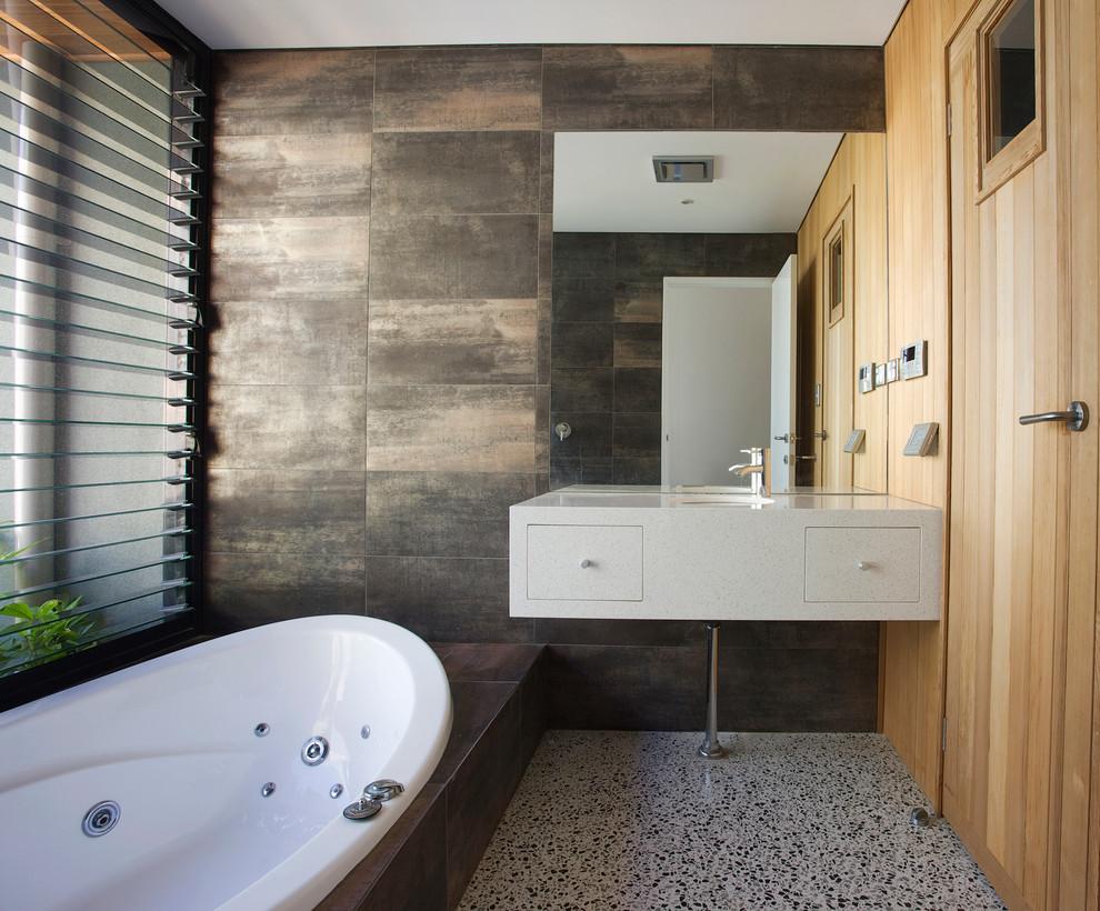 Drop-in bathtub - contemporary brown tile drop-in bathtub idea in Perth with an undermount sink