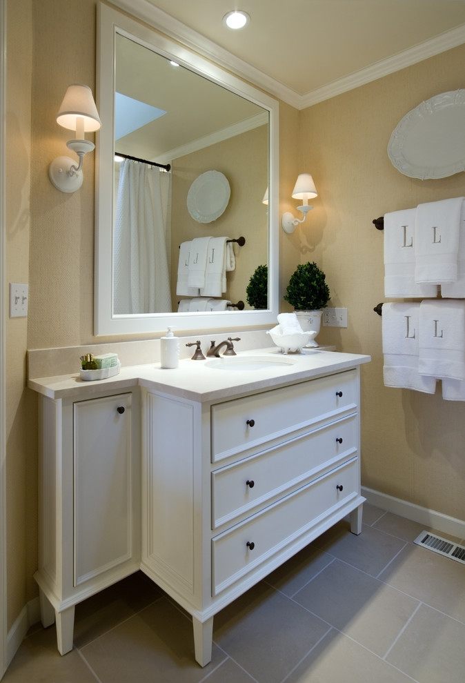 Inspiration for a timeless beige tile bathroom remodel in Portland with an undermount sink, furniture-like cabinets and white cabinets