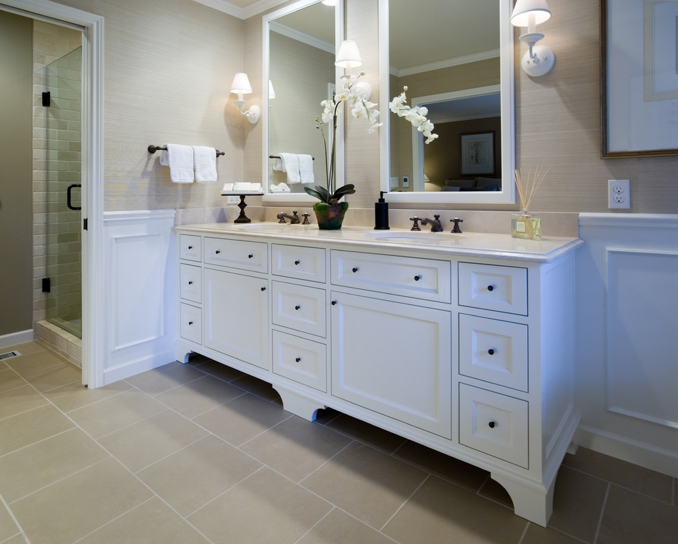 Elegant beige tile corner shower photo in Portland with recessed-panel cabinets and white cabinets
