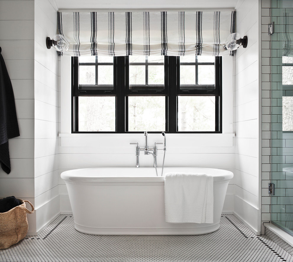 Inspiration for a coastal master white tile and subway tile multicolored floor freestanding bathtub remodel in Toronto with white walls and a hinged shower door