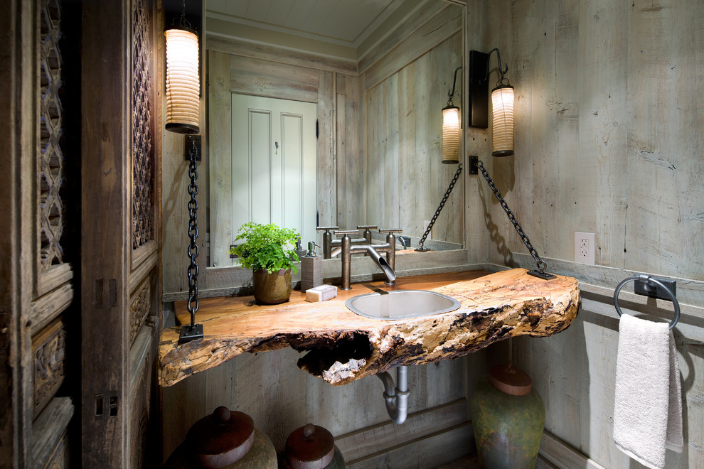 Inspiration for a coastal bathroom remodel in Other with a drop-in sink